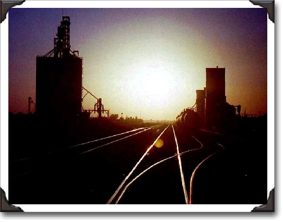 A silhouette of the Elevators looking west at the Indian Head railyards.